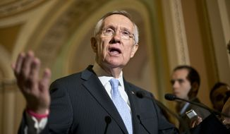** FILE ** Senate Majority Leader Harry Reid, Nevada Democrat, speaks with reporters on Capitol Hill in Washington on Tuesday, July 9, 2013, following a Democratic strategy session. (Associated Press)