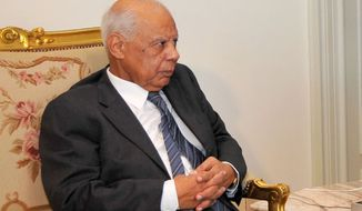 Hazem el-Biblawi, a prominent economist who this week was named Egyptian prime minister, meets with interim President Adly Mansour (not pictured) in Cairo on Tuesday, July 9, 2013. (AP Photo/Egyptian Presidency)