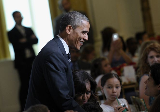 "President Obama greets guests at the second annual White House ""Kids' State Dinner"" in the East Room of the White House in Washington on Tuesday, July 9, 2013. First lady Michelle Obama welcomed 54 children to the Executive Mansion for creating winning recipes as part of a healthy-lunch contest. (AP Photo/Susan Walsh)"