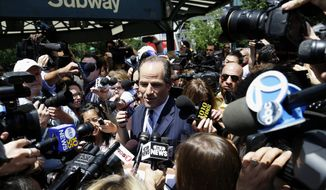 Former New York Gov. Eliot Spitzer is surrounded by the media as he tries to collect signatures for his run for New York City comptroller on Monday, July 8, 2013, in New York. Mr. Spitzer, who stepped down in 2008 from the governorship amid a prostitution scandal, says he is planning a political comeback with his bid for the comptroller's office. (AP Photo/Seth Wenig)