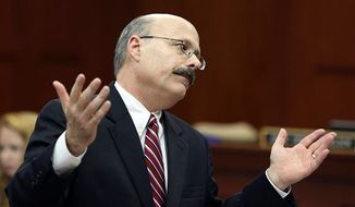Assistant state attorney Bernie de la Rionda presents the state's closing arguments in George Zimmerman's trial in Seminole circuit court in Sanford, Fla. Thursday, July 11, 2013. Zimmerman has been charged with second-degree murder for the 2012 shooting death of Trayvon Martin. (Associated Press)