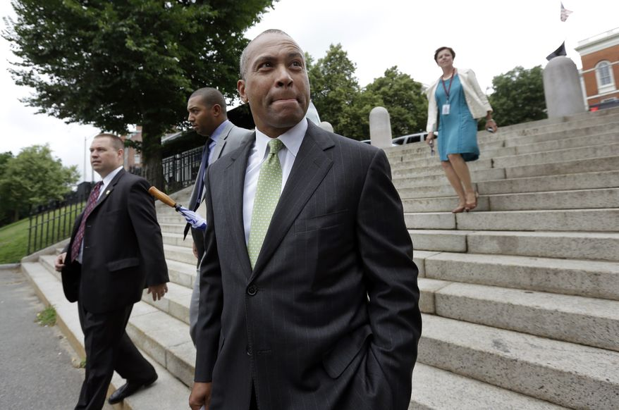 **FILE** Massachusetts Gov. Deval Patrick arrives at a community reading of the Emancipation Proclamation on the Boston Common, in Boston on July 2, 2013. (Associated Press)