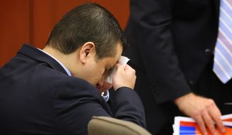 ** FILE ** George Zimmerman wipes his face after arriving in the courtroom for his trial at the Seminole County Criminal Justice Center, in Sanford, Fla., on July 12, 2013. (Associated Press/Orlando Sentinel)