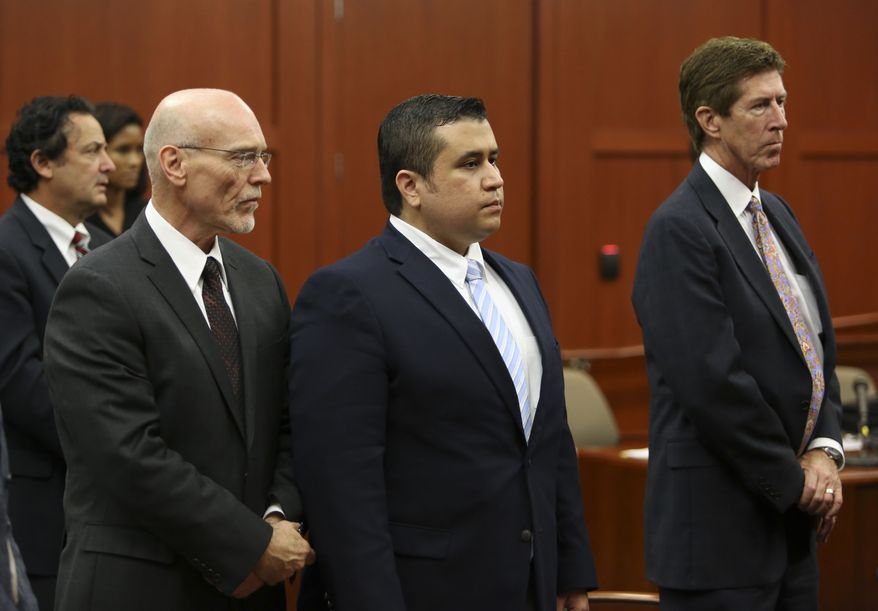 **FILE** Attorneys Don West (front left) and Mark O'Mara (right) stand with George Zimmerman as the selected jurors enter the courtroom during Zimmerman's trial in Seminole Circuit Court in Sanford, Fla., on June 20, 2013. (Associated Press/Orlando Sentinel)