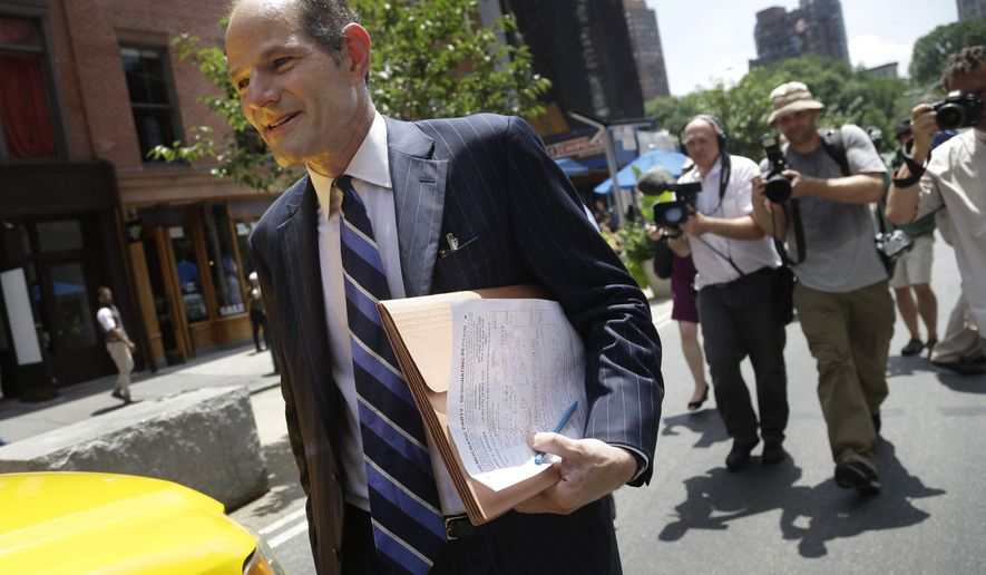 Former New York Gov. Eliot Spitzer walks to a cab after trying to collect signatures for his run for New York City comptroller in Union Square in New York, Monday, July 8, 2013. Spitzer, who stepped down in 2008 amid a prostitution scandal, says he is planning a political comeback with a run for New York City comptroller. (AP Photo/Seth Wenig)