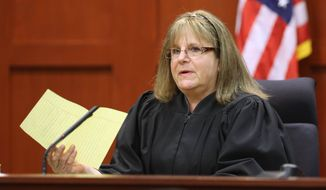 Judge Debra Nelson addresses attorneys after informing them that the jury had a question on instructions for a charge of manslaughter, on the 25th day of Zimmerman's trial at the Seminole County Criminal Justice Center, in Sanford, Fla., Saturday, July 13, 2013. (AP Photo/Orlando Sentinel, Joe Burbank, Pool)