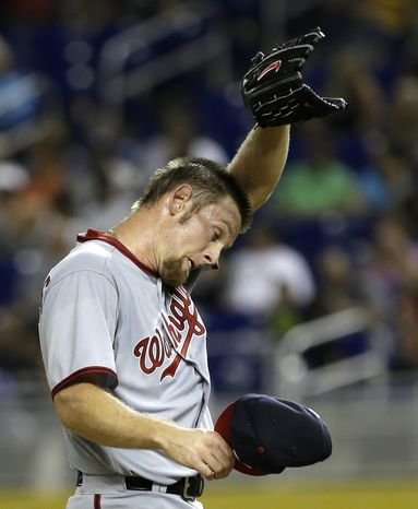 Stephen Strasburg allowed seven earned runs in two innings on Friday night, making the Nationals' 8-3 loss to the Marlins statistically the worst start of his major league career. (Associated Press photo)