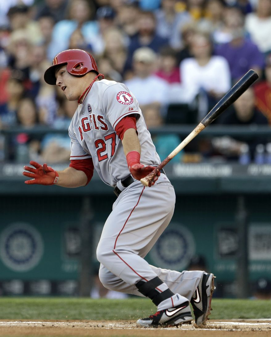 Los Angeles Angels' Mike Trout grounds out against the Seattle Mariners in the first inning of a baseball game Saturday, July 13, 2013, in Seattle. (AP Photo/Elaine Thompson)