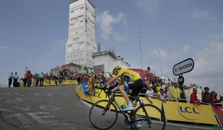 Stage winner Christopher Froome of Britain, wearing the overall leader's yellow jersey, climbs in the last 100 meters of the Mont Ventoux pass during the fifteenth stage of the Tour de France cycling race over 242.5 kilometers (150.7 miles) with start in in Givors and finish on the summit of Mont Ventoux pass, France, Sunday July 14, 2013. The riders climbed to an altitude of 1912 meters (6,273 Feet) tackling Mont Ventoux pass at the end of the longest stage of the 100th Tour de France edition. (AP Photo/Laurent Rebours)