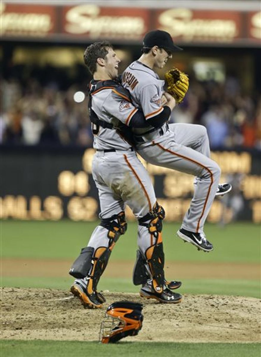 San Francisco Giants starting pitcher Tim Lincecum gets lifted by catcher Buster Posey after his no hit game against the San Diego Padres in a baseball game in San Diego, Saturday, July 13, 2013. The Giants won the game 9-0. Tim Lincecum has thrown his first career no-hitter and the second in the majors in 11 days, a gem saved by a spectacular diving catch by right fielder Hunter Pence in the San Francisco Giants' 9-0 win against the last-place San Diego Padres on Saturday night. (AP Photo/Lenny Ignelzi)