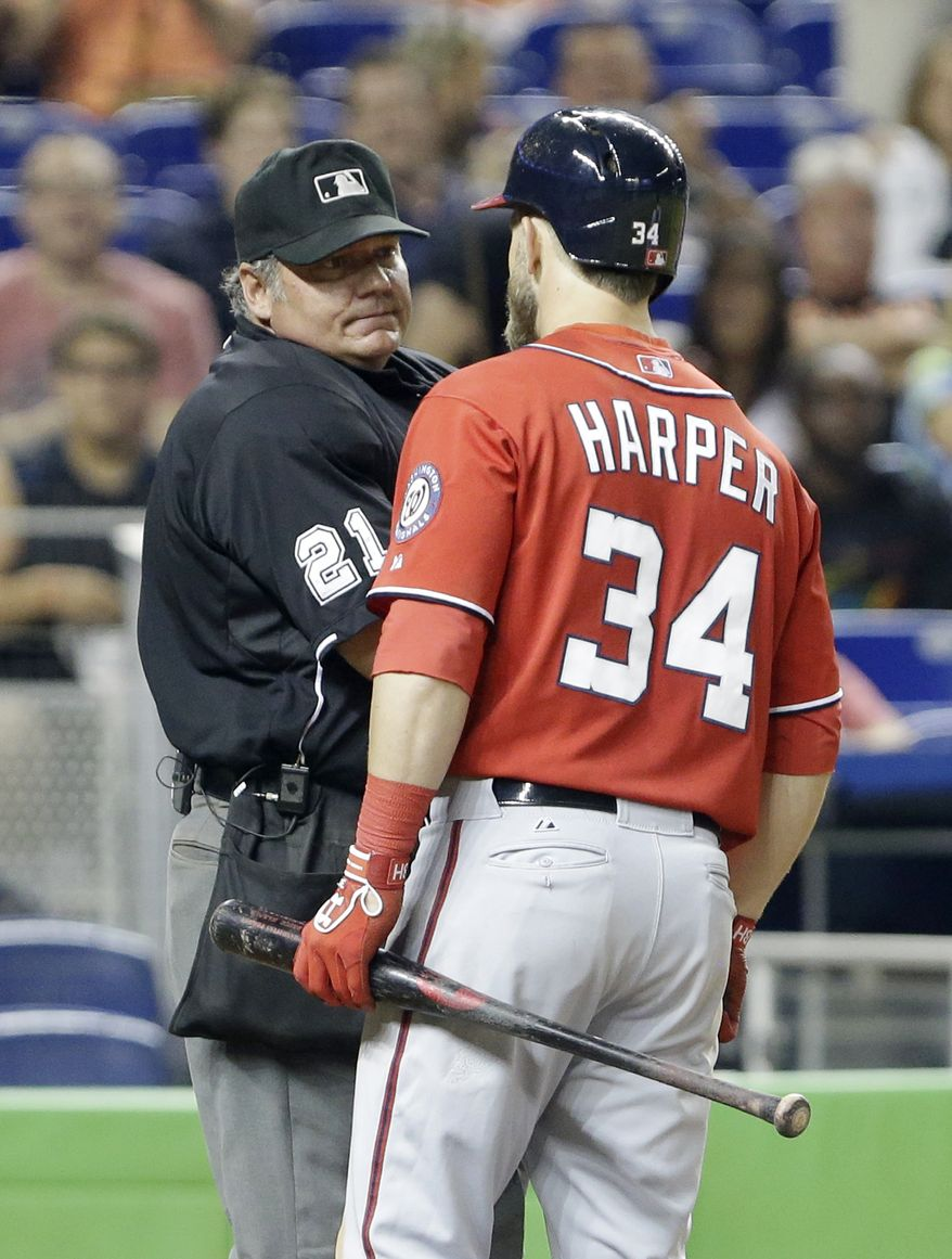 Bryce Harper is ejected by home plate umpire Hunter Wendelstedt in the eighth inning of the Nationals' 2-1 loss to the Marlins on Saturday night. (Associated Press photo)