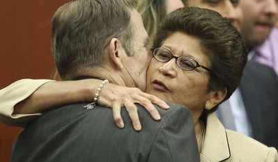 Robert Zimmerman Sr. and Gladys Zimmerman embrace following their son George Zimmerman's acquittal in Seminole Circuit Court in Sanford, Fla. on Saturday, July 13, 2013. (AP Photo/Gary W. Green, Pool)