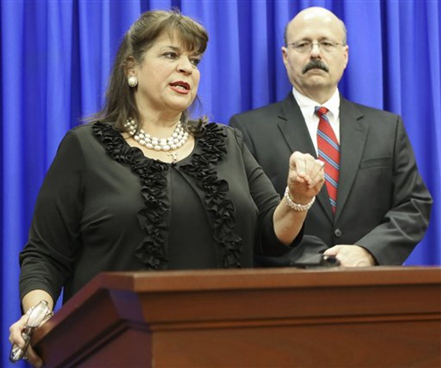 ** FILE ** Florida State Attorney Angela Corey and Assistant State Attorney Bernie de la Rionda address the media following the not guilty verdict of George Zimmerman in Seminole Circuit Court in Sanford, Fla. on Saturday, July 13, 2013. Jurors found Zimmerman not guilty of second-degree murder in the fatal shooting of 17-year-old Trayvon Martin in Sanford, Fla. (AP Photo/Gary W. Green, Pool)