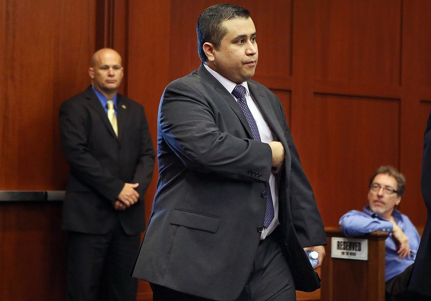 George Zimmerman enters the courtroom for his trial before the jury continued deliberations in Seminole Circuit Court in Sanford, Fla., on Saturday, July 13, 2013. Mr. Zimmerman had been charged in the 2012 shooting death of Trayvon Martin. (AP Photo/Orlando Sentinel, Gary W. Green, Pool)