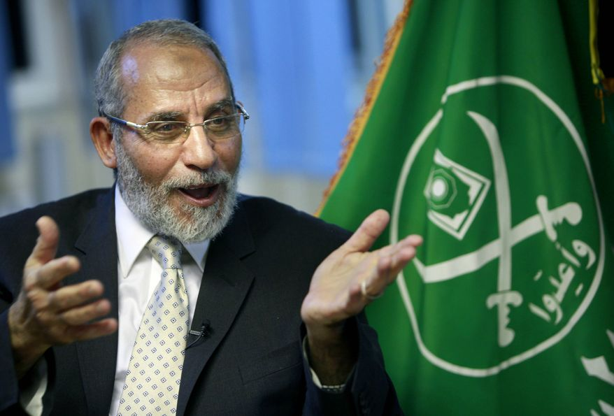 ** FILE ** In this Tuesday, Oct. 26, 2010, file photo, Muslim Brotherhood supreme leader Mohammed Badie talks during an interview with the Associated Press at his office in Cairo Egypt. (AP Photo/Amr Nabil, File)