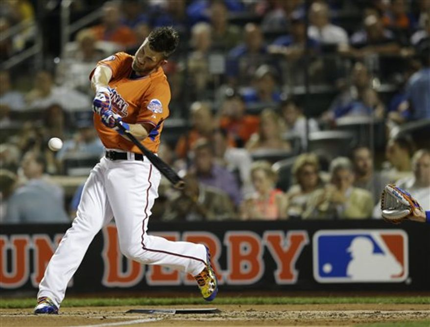 National League's Bryce Harper, of the Washington Nationals, hits a 471 foot, seventh home run, during the MLB All-Star baseball Home Run Derby, on Monday, July 15, 2013 in New York. (AP Photo/Kathy Willens)