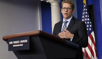 ** FILE ** White House press secretary Jay Carney gives his daily briefing at the White House in Washington on Friday, July 12, 2013. (AP Photo/Susan Walsh)