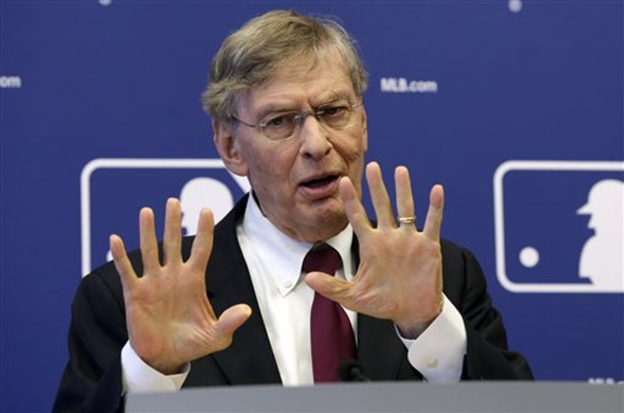 """FILE - In this May 16, 2013 file photo, commissioner Bud Selig answers a question during a news conference at Major League Baseball headquarters, in New York. Selig insists """"this sport is cleaner than it's ever been."""" Speaking Monday, July 15, 2013, during a question-and-answer session arranged by Politico, Selig defended baseball's drug-testing program, which began for the 2003 season. (AP Photo/Richard Drew, File)"""
