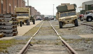 Military Humvee vehicles sit idle at Letterkenny Army Depot. Military chiefs have delayed maintenance for equipment returning from Afghanistan because of budget cuts. (Andrew Harnik/The Washington Times) ** FILE **