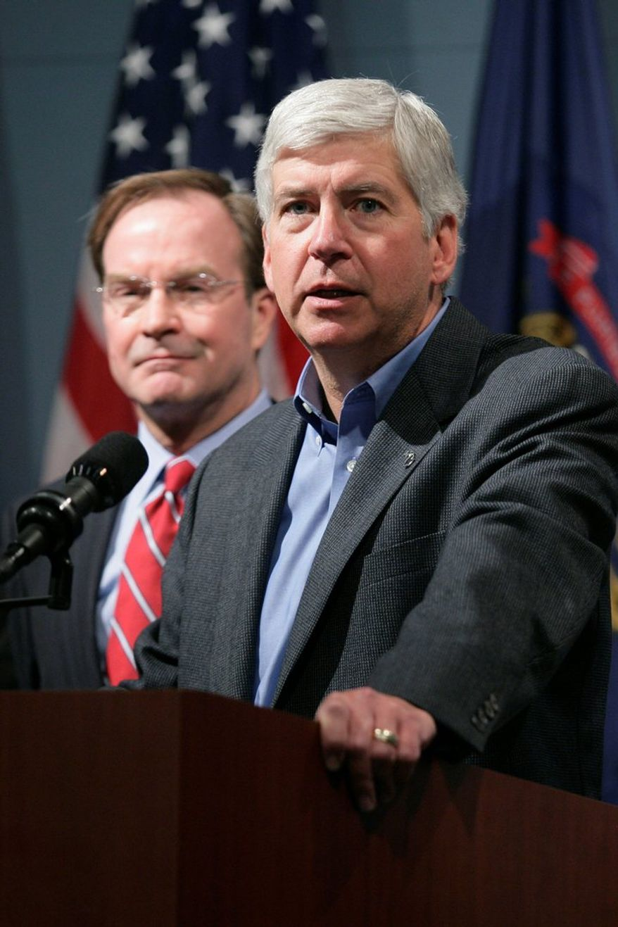 Michigan Gov. Rick Snyder, a Republican, asked the state's Supreme Court for an advisory opinion on the right-to-work law, but the justices declined to weigh in. Supporters say the reluctance is not an indication of how the court will eventually rule. (Associated Press)