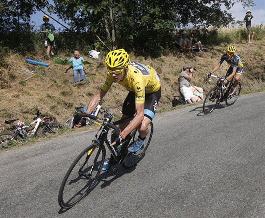 Christopher Froome of Britain, wearing the overall leader's yellow jersey, and Spain's Alberto Contador, right, speed down manse pass in the last kilometers of the sixteenth stage of the Tour de France cycling race over 168 kilometers (105 miles) with start in in Vaison-la-Romaine and finish in Gap, France, Tuesday July 16, 2013. (AP Photo/Laurent Cipriani)