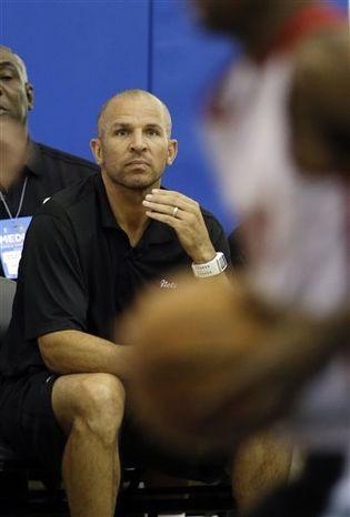 FILE - Brooklyn Nets head coach Jason Kidd watches his team play against the Miami Heat during an NBA summer league basketball game, in this July 8, 2013 file photo taken in Orlando, Fla. (AP Photo/John Raoux, File)