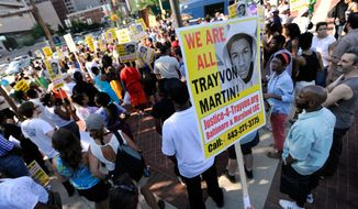 Several hundred people gather in Baltimore on Monday, July 15, 2013, for a demonstration after the acquittal of neighborhood watch member George Zimmerman, who was found not guilty Saturday in the 2012 shooting death of Trayvon Martin in Sanford, Fla. (AP Photo/Steve Ruark)
