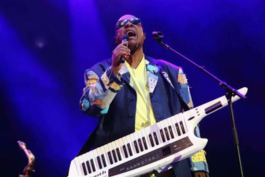 """Stevie Wonder, seen here performing in Gulf Shores, Ala. in May, says he won't perform in Florida """"until the 'stand your ground' law is abolished in Florida."""" (Photo by John Davisson/Invision/AP, File)"""