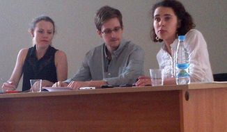 ** FILE ** National Security Agency leaker Edward Snowden (center) attends a meeting with Russian activists and officials at Sheremetyevo Airport in Moscow on Friday, July 12, 2013. (AP Photo/Tatyana Lokshina, Human Rights Watch)