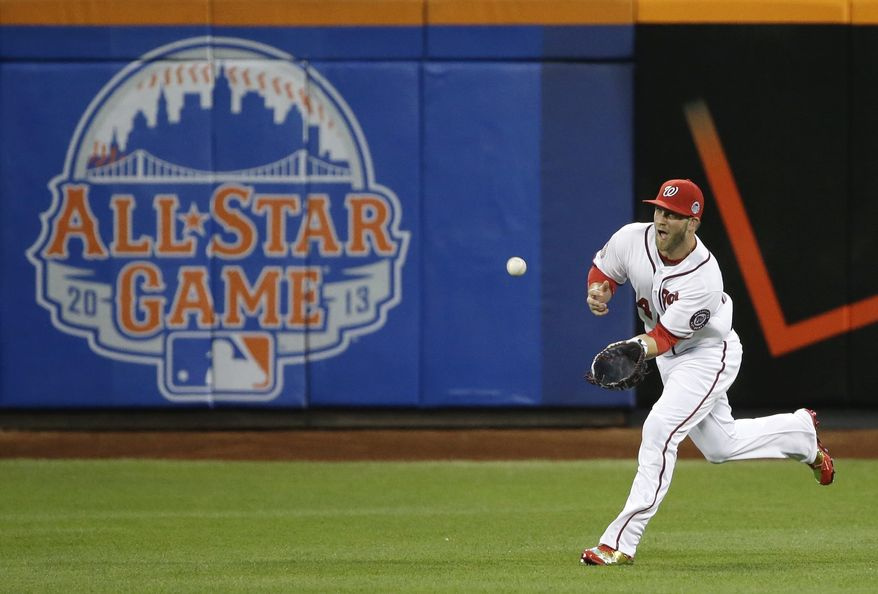 Bryce Harper catches a fly ball in the All-Star Game. (Associated Press photo)