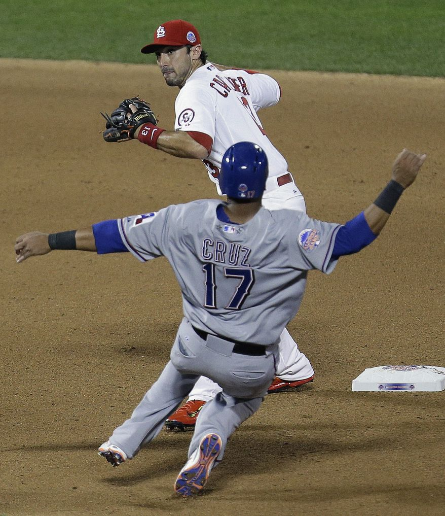 American League's Nelson Cruz, of the Texas Rangers, is out at second as National League's Matt Carpenter, of the St. Louis Cardinals, turns a double play on a ball hit by Edwin Encarnacion during the seventh inning of the MLB All-Star baseball game, on Tuesday, July 16, 2013, in New York. (AP Photo/Julio Cortez)