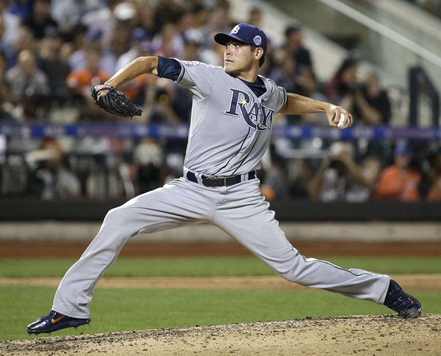 American League's Matt Moore, of the Tampa Bay Rays, pitches during the sixth inning of the MLB All-Star baseball game, on Tuesday, July 16, 2013, in New York. (AP Photo/Matt Slocum)