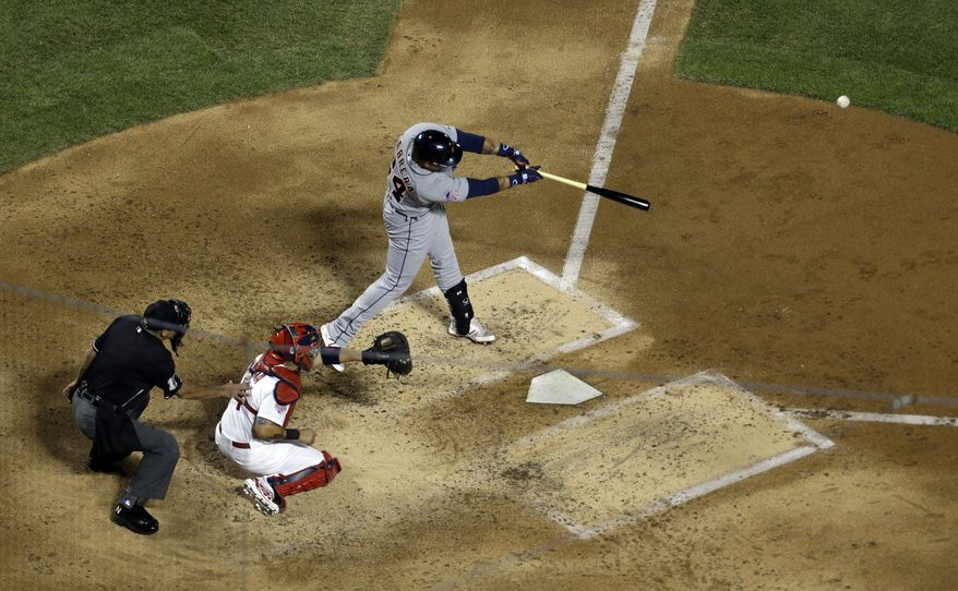 American League's Miguel Cabrera, of the Detroit Tigers, hits a double during the fourth inning of the MLB All-Star baseball game, on Tuesday, July 16, 2013, in New York. (AP Photo/Julio Cortez)
