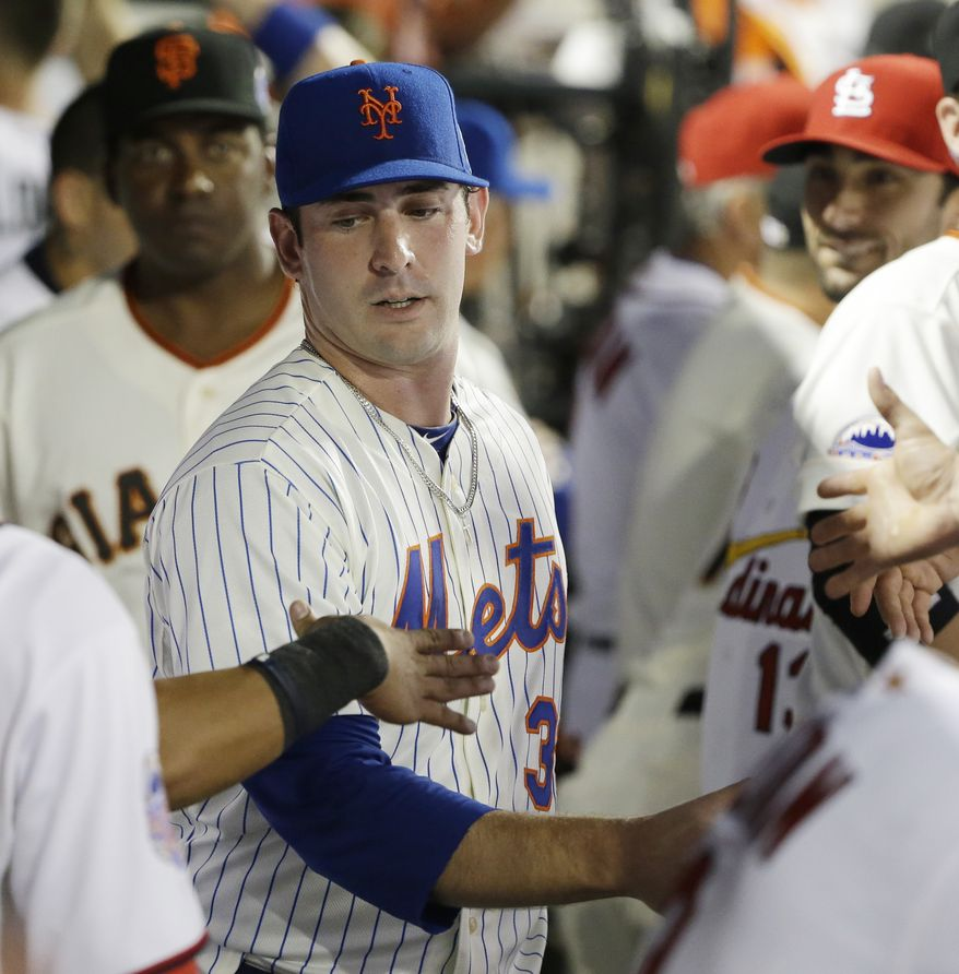National League's Matt Harvey, of the New York Mets, is congratulated by teammates after pitching during the MLB All-Star baseball game, on Tuesday, July 16, 2013, in New York. (AP Photo/Matt Slocum)