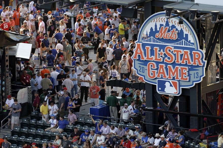 Fans wait for the start of the MLB All-Star baseball game, on Tuesday, July 16, 2013, in New York. (AP Photo/Julio Cortez)