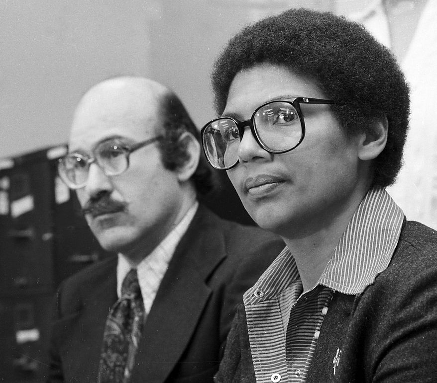 **FILE** Rower Anita DeFrantz, right, announces an athlete's suit against the U.S. Olympic Committee for depriving Americans the opportunity to compete in the Moscow Games at a news conference in New York City, Wednesday, April 24, 1980. A number of athletes joined the 1976 Olympic bronze medalist in the suit filed in Washington, D.C. At left is Ira Glasser, executive director of the American Civil Liberties Union. (AP Photo/Burnett)