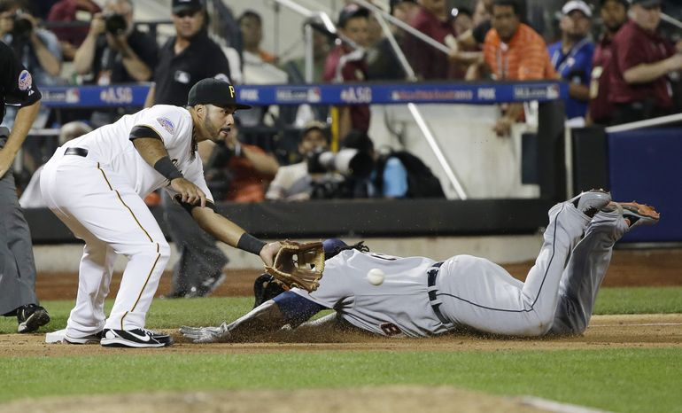 American League's Prince Fielder, of the Detroit Tigers, dives into third base for a triple  ahead of the throw to National League's Pedro Alvarez, of the Pittsburgh Pirates, in the ninth inning of the MLB All-Star baseball game, on Tuesday, July 16, 2013, in New York. (AP Photo/Matt Slocum)