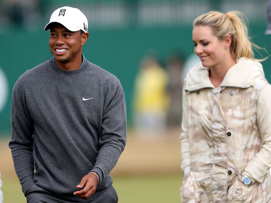 Tiger Woods and his girlfriend US skier Lindsey Vonn, are seen together during a practice round ahead of the British Open Golf Championship, Muirfield, Scotland, Monday, July 15, 2013. The British Open begins on Thursday, July 18. (AP Photo/Scott Heppell)