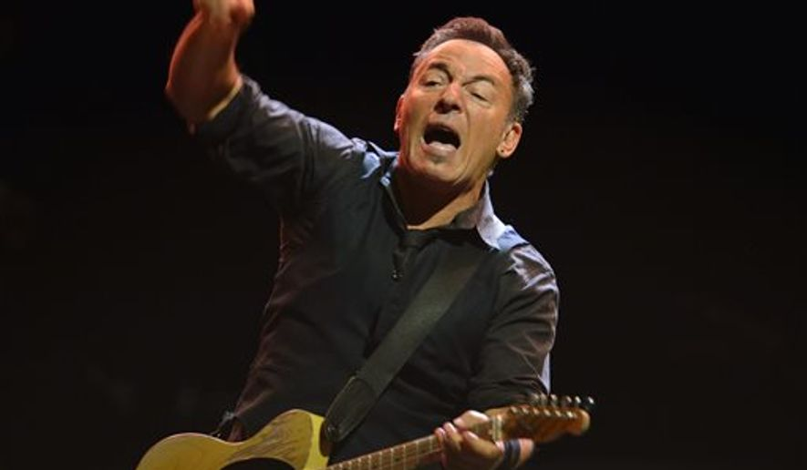 """Bruce Springsteen dedicated his protest song """"American Skin (41 Shots)"""" to the late teen Trayvon Martin at a concert in Limerick, Ireland on Tuesday. The singer-songwriter is shown here performing with the E Street Band at a concert in Stockholm. (AP Photo/Henrik Montgomery)   SWEDEN OUT"""