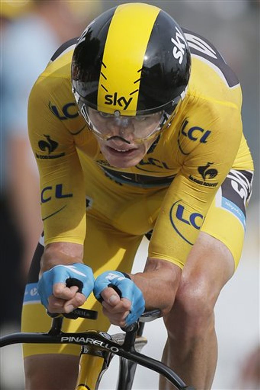 Stage winner Christopher Froome of Britain, wearing the overall leader's yellow jersey, strains in the last meters of the seventeenth stage of the Tour de France cycling race an individual time trial over 32 kilometers (20 miles) with start in Embrun and finish in Chorges, France, Wednesday July 17, 2013. (AP Photo/Laurent Rebours)