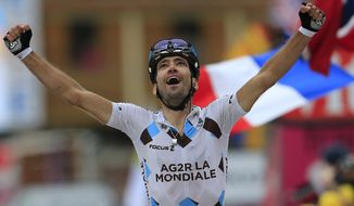 Christophe Riblon of France crosses the finish line to win the eighteenth stage of the Tour de France cycling race over 172.5 kilometers (107.8 miles) with start in Gap and finish in Alpe-d'Huez, France, Thursday July 18, 2013. (AP Photo/Peter Dejong)