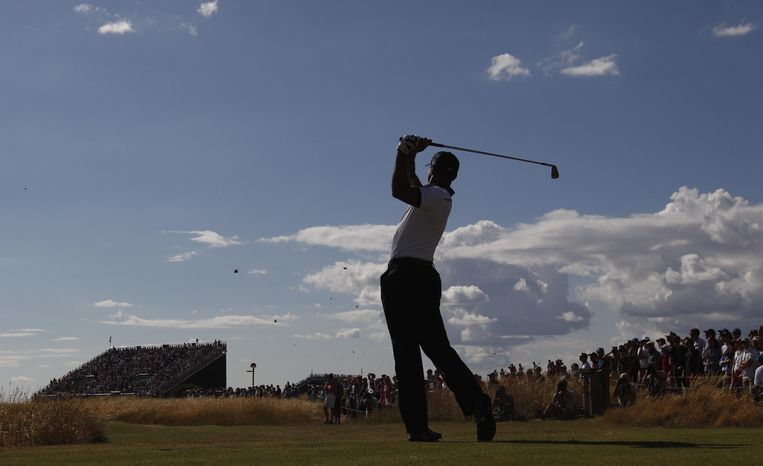 Tiger Woods of the United States plays a shot off the 7th tee during the first round of the British Open Golf Championship at Muirfield, Scotland, Thursday July 18, 2013. (AP Photo/Jon Super)