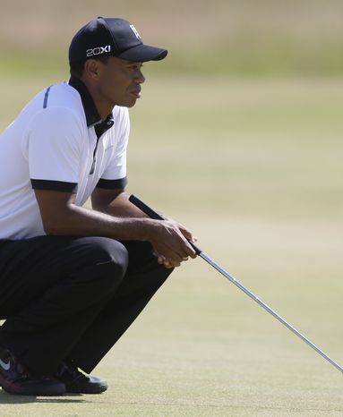 Tiger Woods of the United States gestures on the 6th fairway during the first round of the British Open Golf Championship at Muirfield, Scotland, Thursday July 18, 2013. (AP Photo/Jon Super)