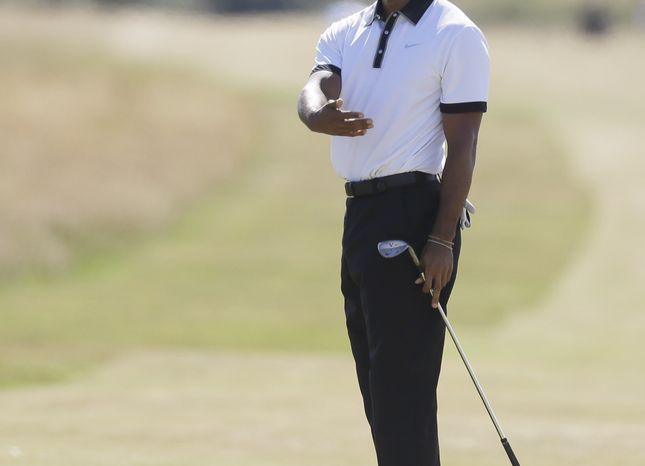 Tiger Woods of the United States plays a shot off the 6th tee during the first round of the British Open Golf Championship at Muirfield, Scotland, Thursday July 18, 2013. (AP Photo/Jon Super)
