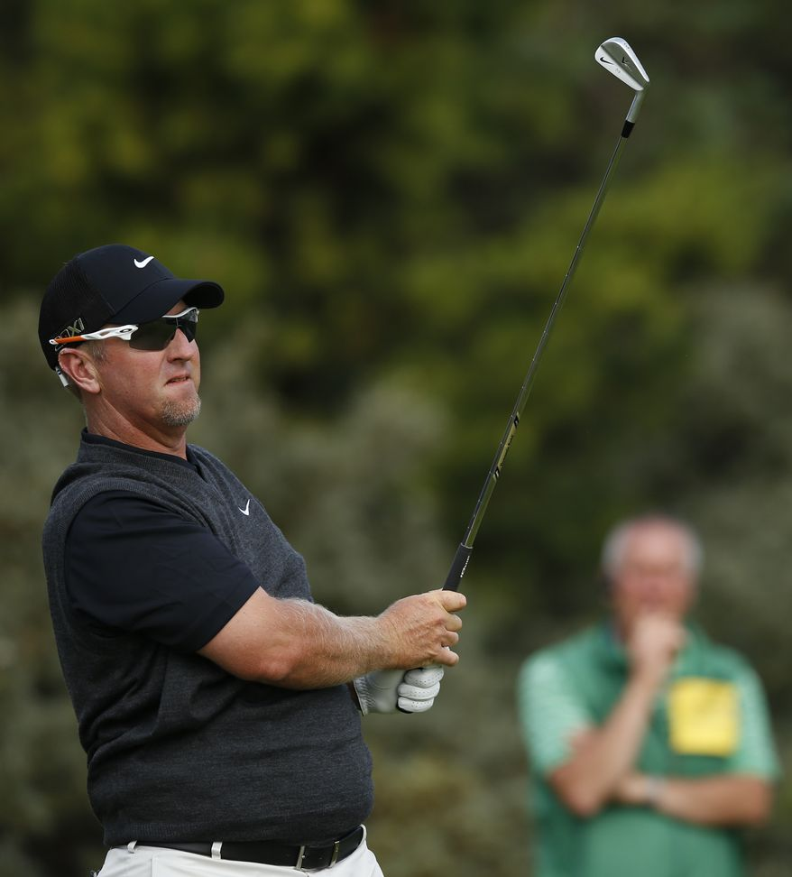 David Duval of the United States plays a shot off the third tee during the first round of the British Open Golf Championship at Muirfield, Scotland, Thursday July 18, 2013. (AP Photo/Matt Dunham)