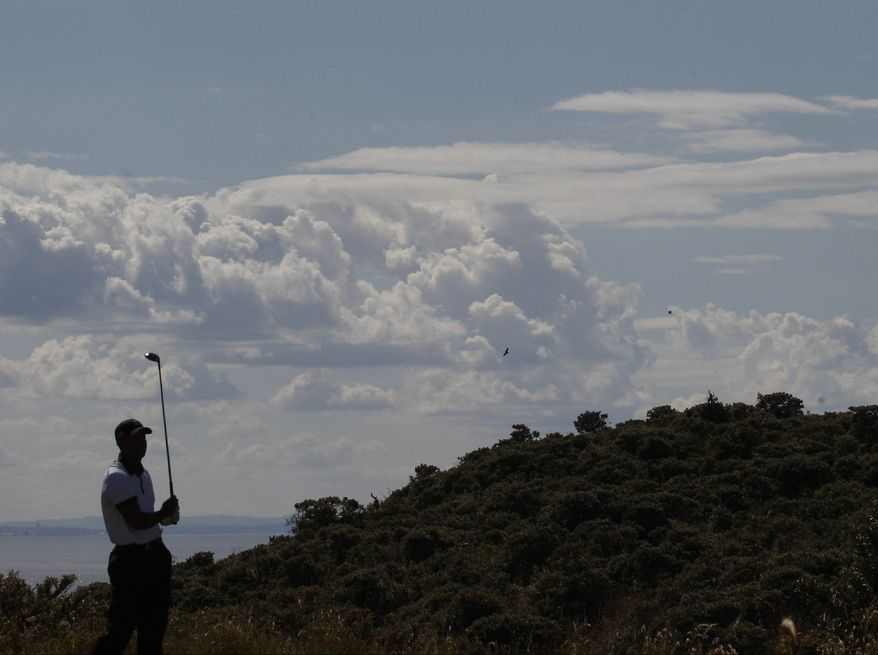 Dustin Johnson of the United States, left, and Bubba Watson of the United States talk on the 6th tee during the first round of the British Open Golf Championship at Muirfield, Scotland, Thursday July 18, 2013. (AP Photo/Scott Heppell)