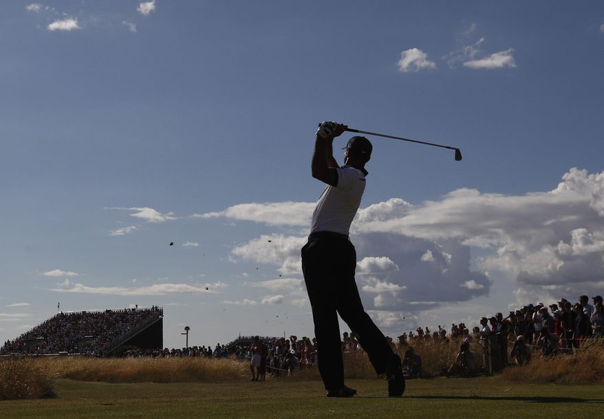 Tiger Woods of the United States prepares to play on the 5th fairway during the first round of the British Open Golf Championship at Muirfield, Scotland, Thursday July 18, 2013. (AP Photo/Jon Super)