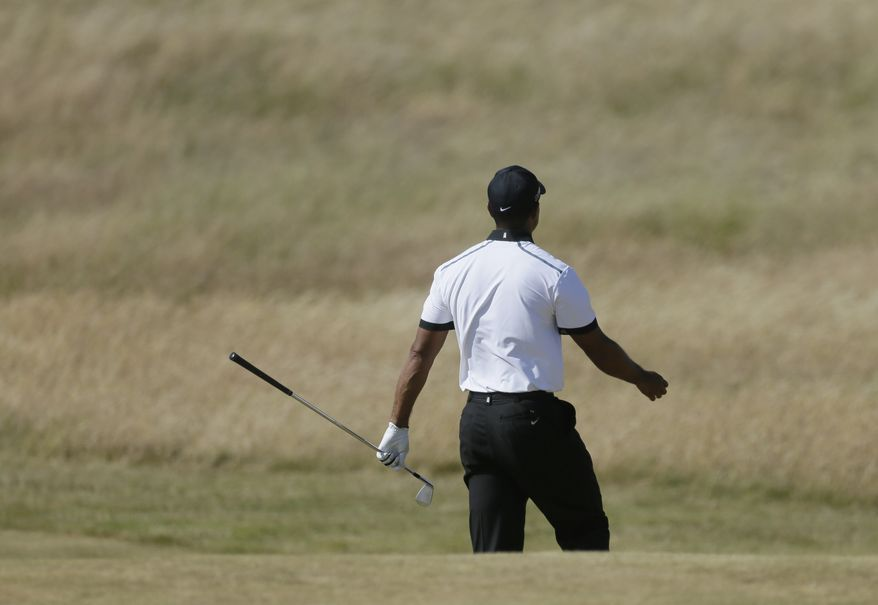 Tiger Woods of the United States waits to play on the 5th fairway during the first round of the British Open Golf Championship at Muirfield, Scotland, Thursday July 18, 2013. (AP Photo/Jon Super)