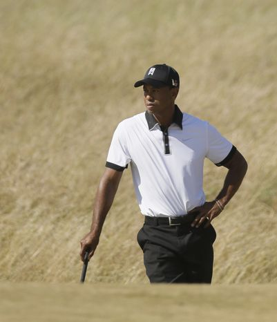 Tiger Woods of the United States gestures on the 7th green during the first round of the British Open Golf Championship at Muirfield, Scotland, Thursday July 18, 2013. (AP Photo/Jon Super)