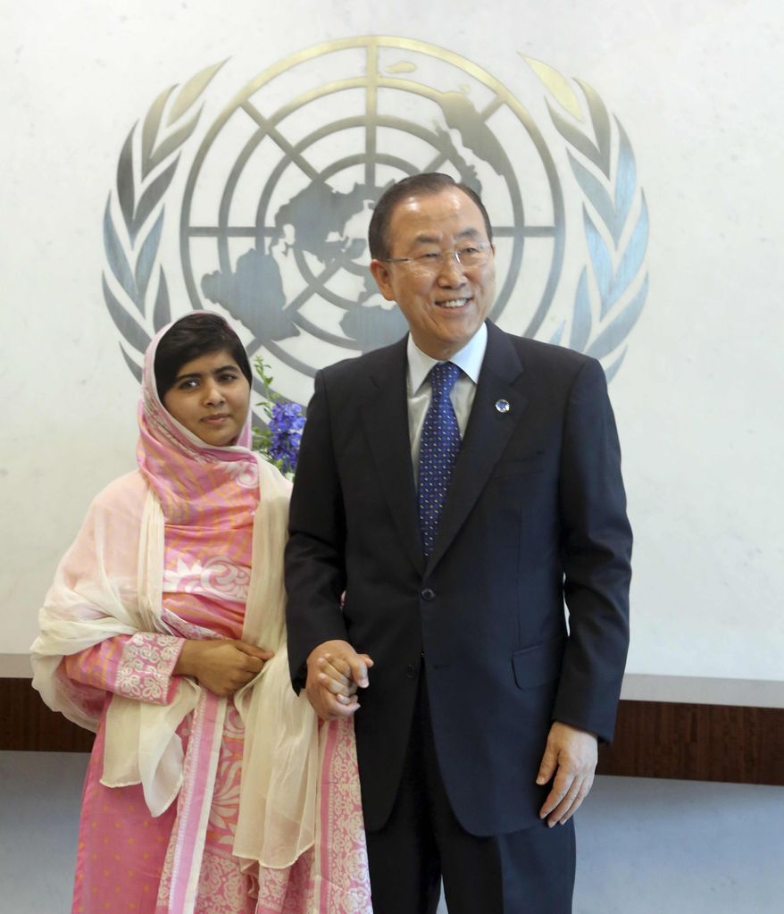 United Nations Secretary-General Ban Ki-moon, right, holds Malala Yousafzai's hand while posing for photographers, Friday, July 12, 2013, at United Nations headquarters. Malala Yousafzai, the Pakistani teenager shot by the Taliban for promoting education for girls, celebrated her 16th birthday on Friday addressing the United Nations. (AP Photo/Mary Altaffer)